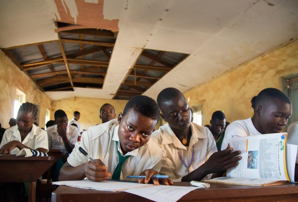 Students from Timbiro Secondary School doing a Biology exam in a temporary classroom