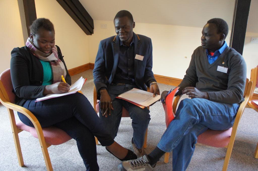 Three students discuss conflict resolution
