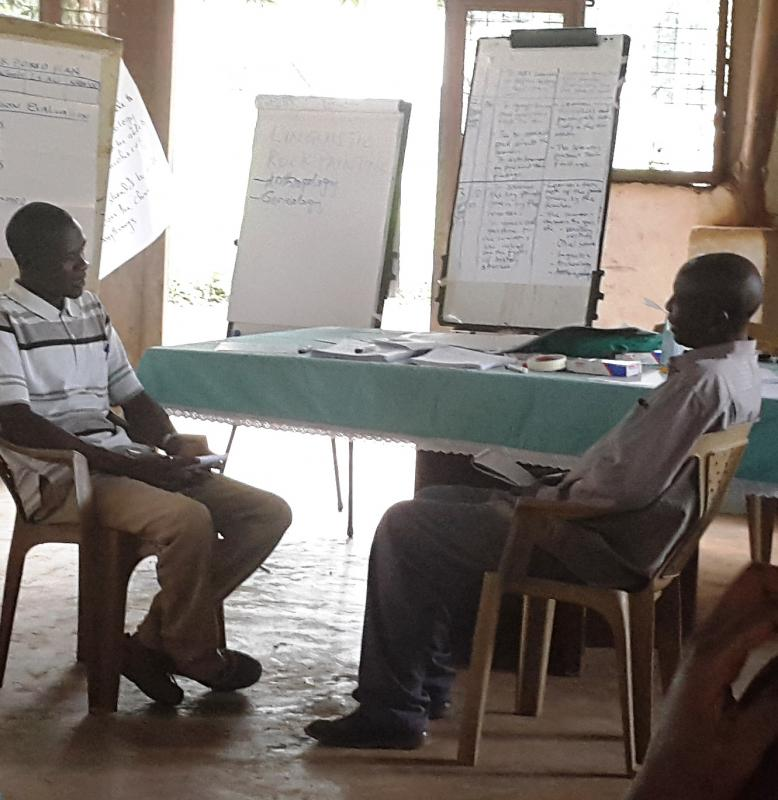 Two secondary school teachers acting in a role play on the relationship between a headteacher and a member of staff.