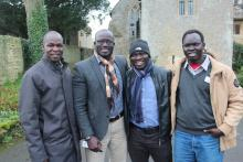 Staff member Mario and three male students
