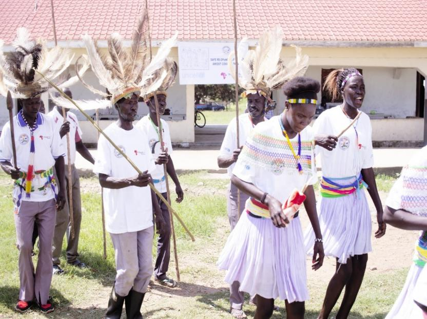 Traditional Dancers sing and dance to send children back to school at Ngulere Primary School