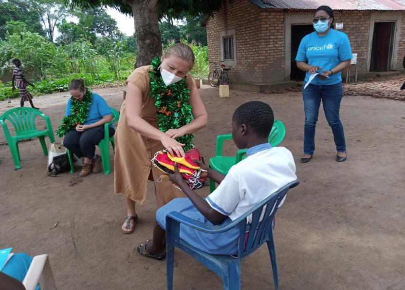 Ms Janika Walter, the German Deputy Head of Mission, gives face masks to a pupil.