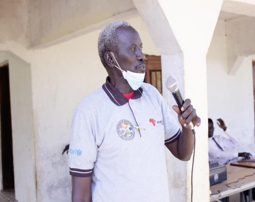 Juba County Education Director giving his speech encouraging the community to send children to school