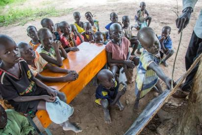Children take Mathematics lessons under a tree in Aber school, Rumbek